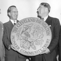 Although the foundation's trailblazing was a faded tradition by 1955, when this picture of the trustee bank presidents holding a replica of the foundation's logo was snapped, its stature as the world's first community trust remained a source of pride.