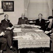 Foundation leaders confer about how to distribute 1947 income of $614,479 to a standing list of charitable institutions and agencies. Foundation director Leyton E. Carter (third from right) is seated next to the board's sole female member, Constance Mather Bishop.