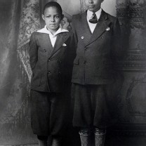 After their father's untimely death, future political icons Carl (left) and Louis Stokes lived with their mother at Outhwaite Homes.