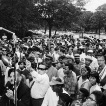 Dr. King speaking in Rockefeller Park on a visit to Cleveland in 1967. The previous year he had dramatized the issue of housing discrimination by moving his family into a grimy apartment on the segregated west side of Chicago and joining in protest marches into that city's all-white neighborhoods.
