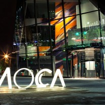 MOCA Cleveland's faceted, mirrored, four-story art gallery anchors the Uptown development.